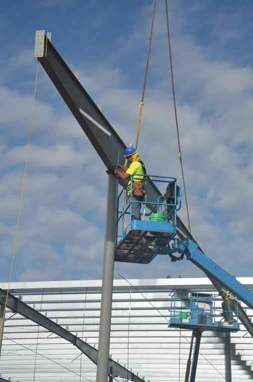 Swinging Steel Into Position